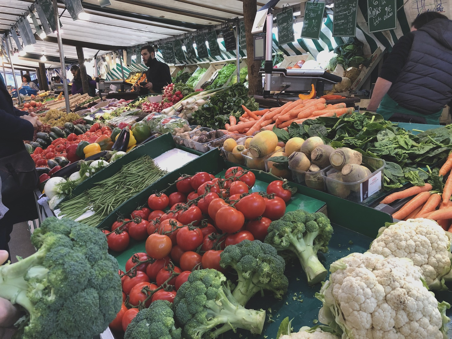 Tomatoes, broccoli, green beans, vegatables at a French market